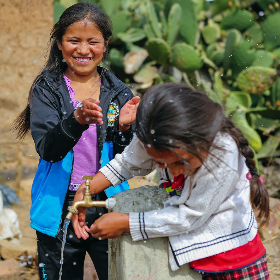 Girls in Bolivia at water pump